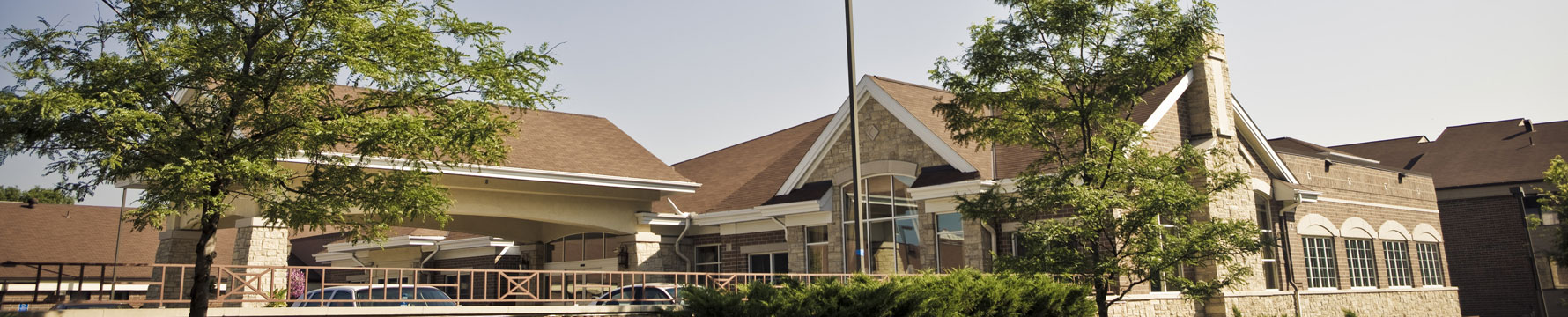 The front entrance to Friendship Village of Bloomington retirement community