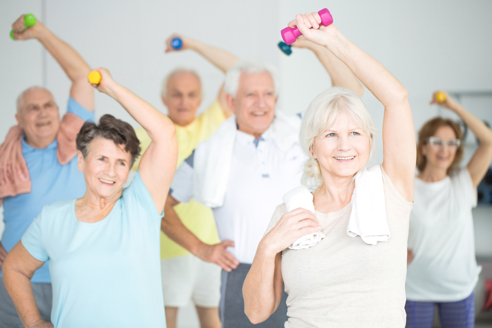 Group of seniors participating in fitness class