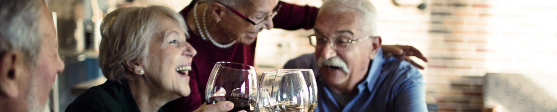 A group of seniors enjoying glasses of wine