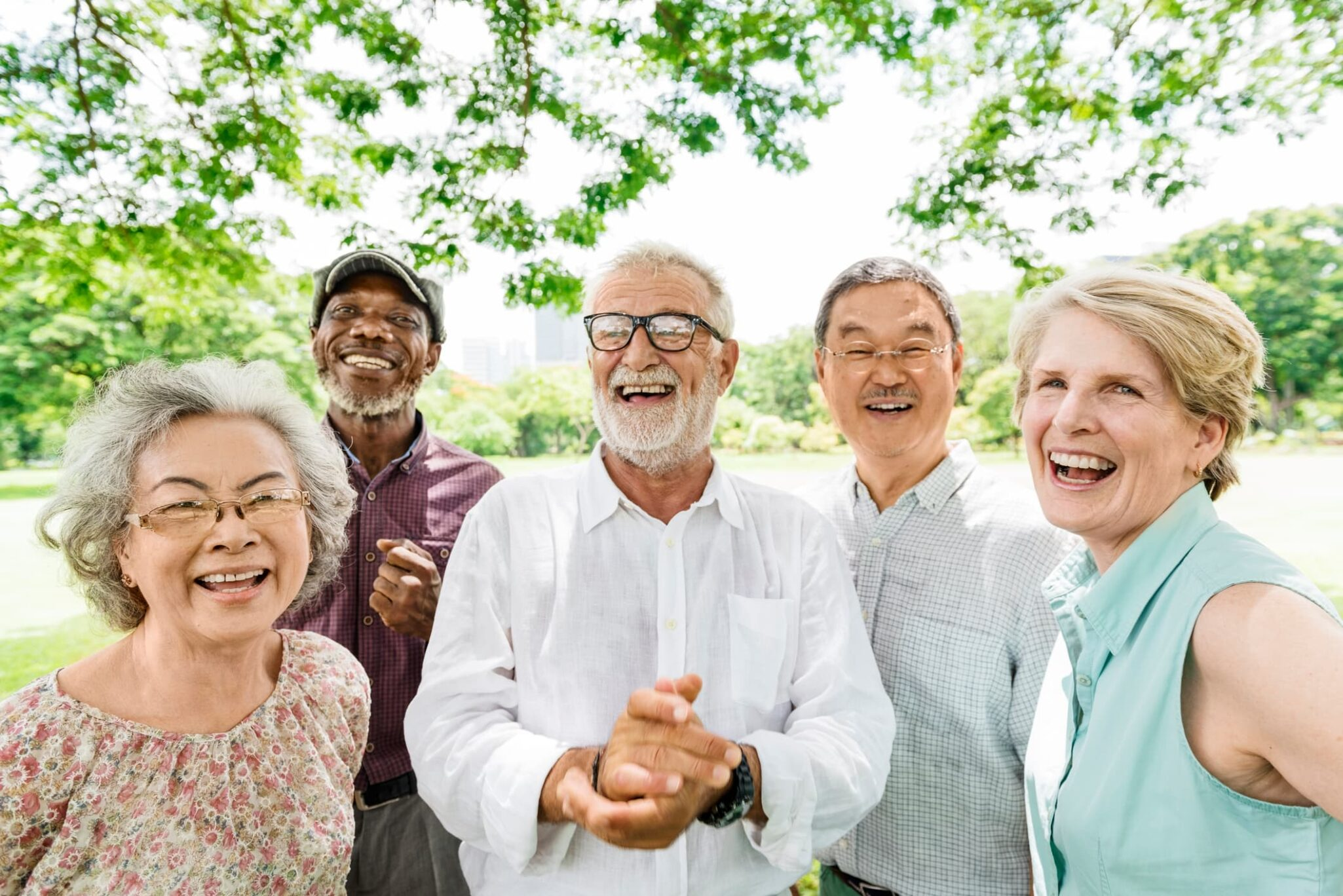A group of friendly retirees having fun outside.
